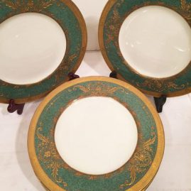 Set of twelve stippled green Royal Worcester dinner plates with heavy raised gilding.It is a very rare color Circa-1929. Size-10 5/8 inches. Price on Request.