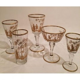 Extensive set of antique gilded crystal stemware each painted differently with different pastoral scenes of ladies and lovers. 12 tumblers-5 1/4 inches tall, 11 white wines or ports-5 3/4 inches tall, 9 champagnes or coupes-5 1/4 inches tall, 15 cordial-5 inches tall and 9 goblets-6 5/8 inches tall. Cordials are available. All others are sold.