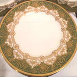 Close-up of set of twelve profusely gilded green Royal Doulton dinner plates. 10 1/2 inch diameter. Circa-1918. Made exclusively for Davis Collamore and Co Inc, Fifth Avenue and 48th St., New York. Sold