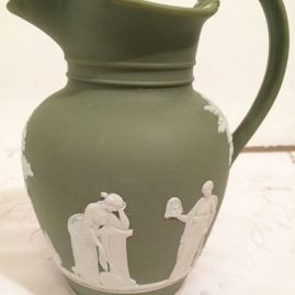 Wedgwood, England green jasperware pitcher, 7 inches tall, circa between 1890s-1920. Price on Request.