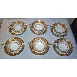 13 Hammersley raised gilt cream soups and saucers made for Ovington Brothers, N.Y