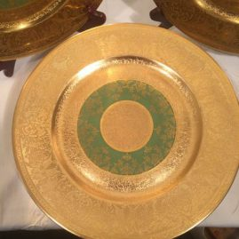 Set of sixteen Heinrich and Company gilded service plates or dinner plates. Circa-1930s. Diameter-11 inches. Price on Request