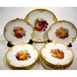 "12 KPM fruit plates, each painted differently, 8 1/2"" and a round platter, 10 3/4"", ca-1913, Sold"