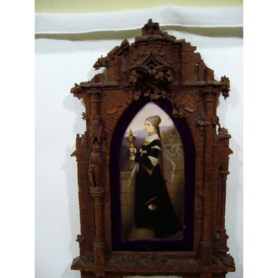 Large KPM plaque in carved Black Forest frame, raised carvings of knights and castles