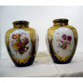 "Pair of KPM cobalt and flowered urns, each with 4 cartouches of flowers, ca-1900-1910, 12"" by 10"", each finely painted, SOLD"