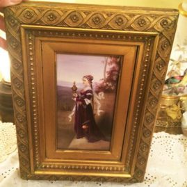 Beautiful porcelain plaque of lady signed Kaulbach, in gilded wood frame. With frame, size is 10 1/2 inches by 14 inches, Without frame, size is 8 1/4 by 4 1/2 inches, Sold