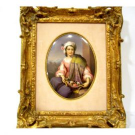 Porcelain plaque of beautiful lady with shawl, without frame 5 1/2 by 7 inches, with frame 11 1/2 by 13 inches.  Sold