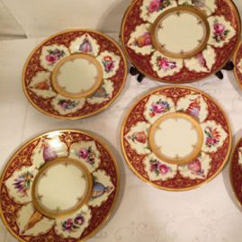 Set of twelve Ambrosius Lamm Dresden plates, each painted differently with different ladies and flowers with raised gilding decoration. Diameter- 7 5/8 inches. Price on Request.