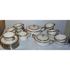 Lenox sterling silver rimmed tea set, teapot, sugar, creamer & 11 cups and saucers