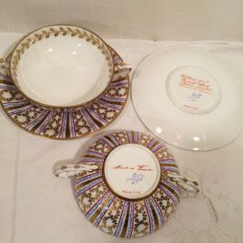 Set of seven Le Tallec made exclusively for Tiffany and company cream soups, with raised gilt decoration,  Sold.
