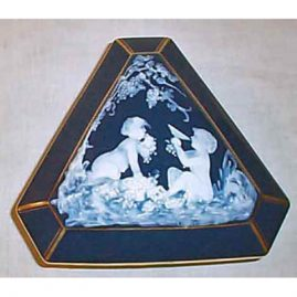 Limoges Pate-Sur-Pate box with cherubs , 7 1/2 inches, sold