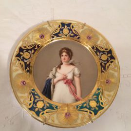 Royal Vienna portrait plate of Queen Marie Louise, artist signed Wagner, with raise gilding and peacock feather decoration, Beehive in red, 9 1/2 inches, Price on Request