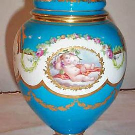 Minton cherub vase with raised flower finial,  11 1/2 inches tall, fine painting, $3500.00