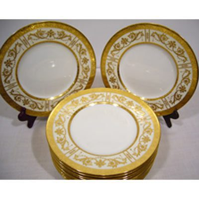 Set of 12 Minton luncheon plates with intricate raised gilding decoratio