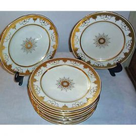 12 Minton dinner plates with raised gilding and gilt jeweling