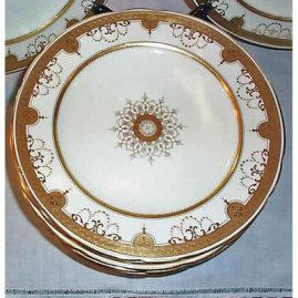 Close up of Minton cream and gilded dinner plate
