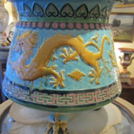 Large Minton majolica jardiniere with three ball and claw feet and dragon decorations all around it. Circa-1871.Size-13 1/2 inches tall and 17 inches wide. Price on Request.