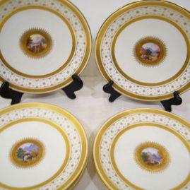 Set of eight Minton scenic plates, each painted with different scenes