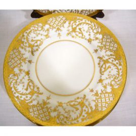 Set of 11 Minton service plates with profuse gilded decoration