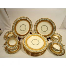Set of 10 Minton made for Tiffany dessert or salad plates, with six matching cream soups and saucers. The cream soups can be sold with the set of plates or separately. Size of plates are 9 inches. Each piece with heavy gold decoration. Sold.