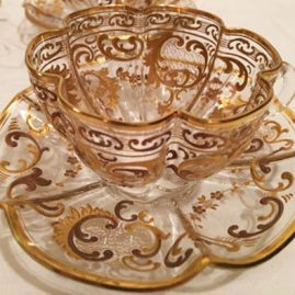Set of eight Moser fluted and gilded cups and saucers. Diameter of fluted saucers-4 3/4 inches. Diameter of cup is 3 1/4 inches. height of cup is 1 7/8 inches, Sold