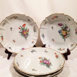 Set of fourteen deep Nymphenburg soup bowls each hand painted with different flower bouquets. Diameter-9 inches. Price on Request.