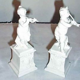 Pair of Nymphenburg cherub musicians, impressed shield marks, 6 1/2 inches tall, only one left-$600.00