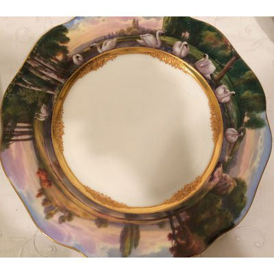 Another view of one of five Dresden Wagnerian opera plates, each painted differently with raised gilt decoration.