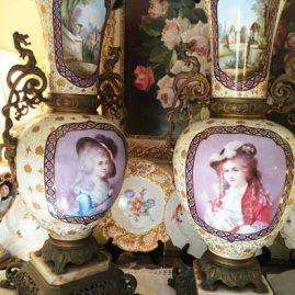 Pair of beautiful Palace Vases with portraits of beautiful ladies in front and different aesthetic movement paintings of birds, butterflies and flowers on the backs of  the vases. They have marble bases and bronze handles and bases. Height-31 inches and width-16 inches. Sold