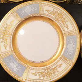 Set of 8 Minton pate sur pate dinner plates artist signed with raised gilding. Sold