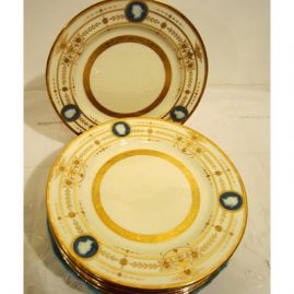 Rare set of 12 Minton pate sur pate dessert or luncheon plates signed Albione Birks with portrait medallions and raised gilding; 9 inch diameter, Sold.