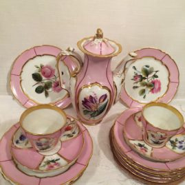 Pink Paris Porcelain tea set, each piece painted with different flower bouquets, 11 cups and saucers, 12 dessert plates, tea or coffee pot, sugar, creamer, waste bowl and two serving trays, Price on Request