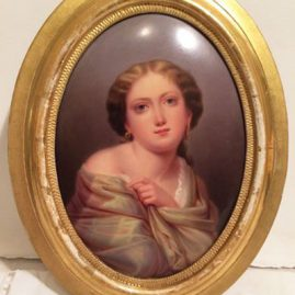 Beautiful KPM porcelain plaque of lady with shawl iin gilt frame. Circa-late 19th century. With frame, measurements are 9 inches tall by 7 inches wide. Unframed, measurements are 6 1/2 inches tall by 4 3/4 inches wide. Price on Request.