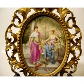 "Porcelain plaque artist signed Wagner in Venetian frame of two ladies in a garden, 5 1/2"" by 7 1/2"" without frame, 13"" by 10 "" with frame, late 19th century, Sold."