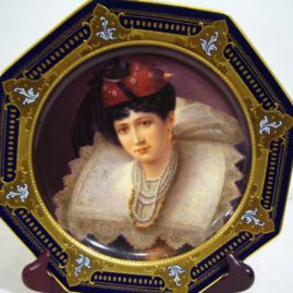 Royal Vienna octagonal cobalt portrait plate artist signed E..Lallerman with under glaze blue beehive mark of lady with lace and pearls. Late 19th century, size-9 1/2 inches. Price on Request