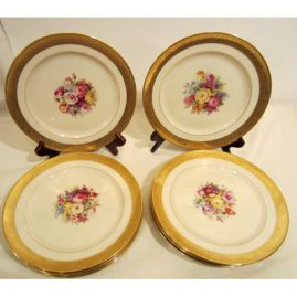 Set of ten green mark Lenox dessert or luncheon plates artist signed W.H. Morley, each hand painted with different bouquets of flowers, ca-1920s, size 9 inch diameter. Sold.
