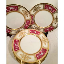 Set of twelve Minton pate sur pate dinner plates made exclusively for Tiffany and Company signed W. Key