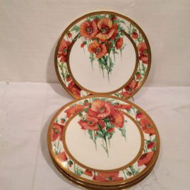 Four Minton poppy plates each painted differently