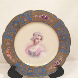 Sevres portrait plate of lovely lady with raised gilding and silver medallions