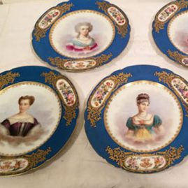 Set of twelve Sevres celeste blue portrait plates, each painted with different ladies of the French court