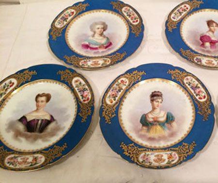 Set of twelve Sevres celeste blue portrait plates