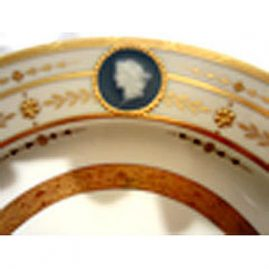 Close-up of one of the three pate sur pate portrait medallions on the set of Minton plates by artist Albione Birks