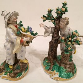 Pair of Nymphenburg figures of lady and man picking and carrying fruit, circa-1930s, Price on Request