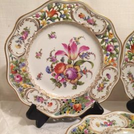 Close up of on of the set of sixteen Carl Thieme Potsnappel Dresden reticulated dinner plates
