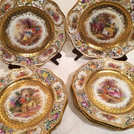 Set of eight Dresden reticulated and jeweled plates, each painted with different scenes of lovers