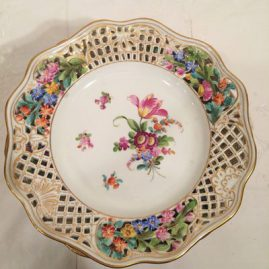 Set of ten reticulated dessert plates each painted with different bouquets