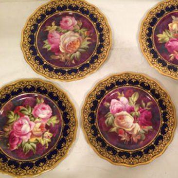 Set of twelve Cauldon hand painted rose plates