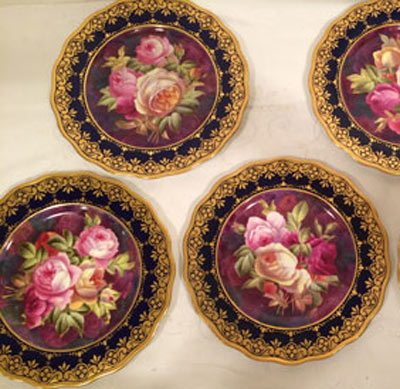 Set of twelve Cauldon hand painted rose plates