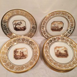 Set of twelve Sevres plates, each painted with different scenes