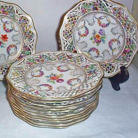 "12 Schumann Bavarian reticulated luncheon plates, Germany, U.S. zoned, 1945-50, 8 1/2"" Price on Request."
